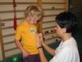 Gosia z medalami za dobre ćwiczenia